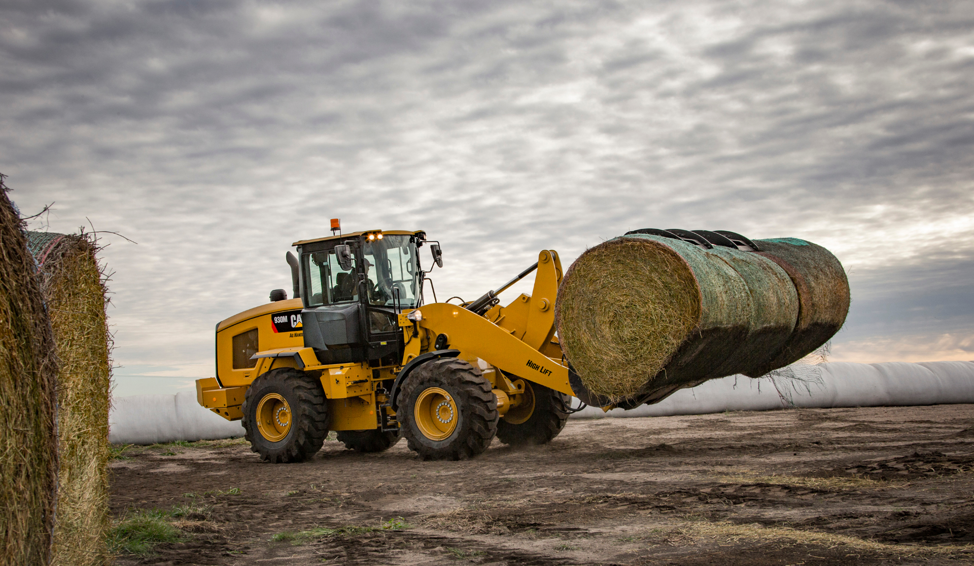 Cat 930M Ag Handler SWL, bales with clouds.jpg